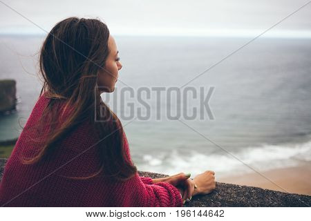 Beautiful woman enjoying sea view wile walking alone on summer evening. Copy-space are for your advertisement text
