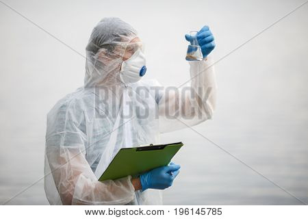 Biologist with bulb and folder
