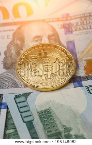 Image of dollars with golden bitcoin,
