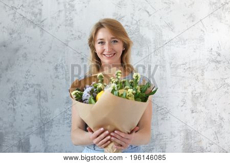 Long-haired woman on empty background