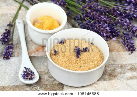 Making homemade body scrub for clear soft skin. Made from granulated sugar coconut oil and lavender flowers