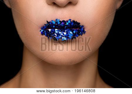 Cropped View Of Fashionable Woman With Blue Sparkles On Lips, Isolated On Black