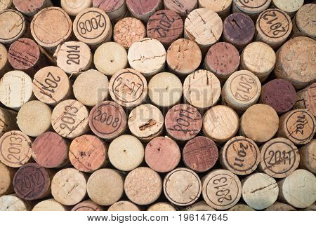 A random of used wine corks Close up wall of used wine corks.