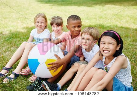 Children in international kindergarden as friends in the park