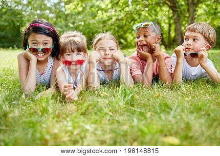 Interracial children as friends showing coolness and wearing sunglasses