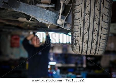 The mechanic checking the car in the garage