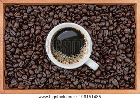 Coffee Cup And Coffee Beans In Box