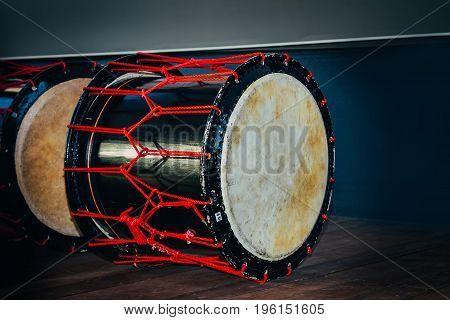 Taiko drums o-kedo on scene background. Musical instrument of Asia Korea Japan China