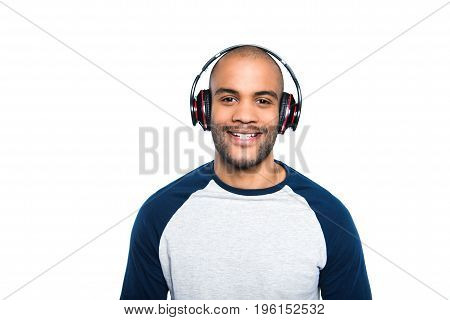 Portrait Of Happy African American Man Listening Music In Headphones And Smiling At Camera Isolated