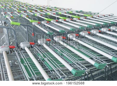 many empty Shopping carts on a parking lot