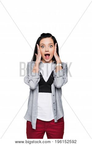 Shocked Young Woman Looking At Camera And Screaming Isolated On White