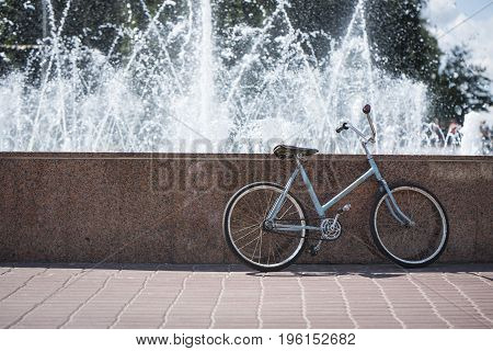 Bicycle near the fountain, hot summer day