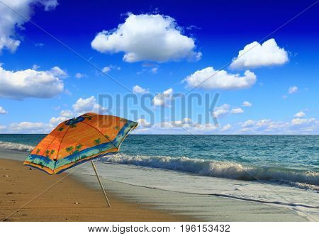 Sun umbrella on sandy beach.