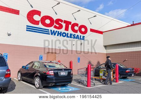 Fairfax, Usa - December 3, 2016: Costco Wholesale Sign On Store In Virginia With Parked Cars And Cus