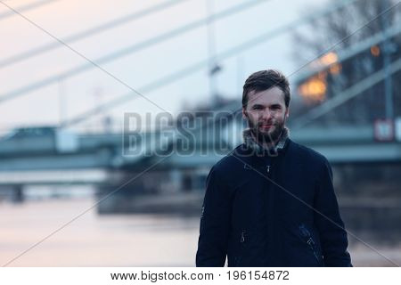 Portrait of young man in urban city.