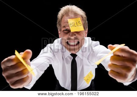 Angry Middle Aged Businessman With Sticky Notes On Clothes Shaking Fists And Looking At Camera Isola