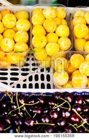 Assortment of Fresh organic fruits on market stall