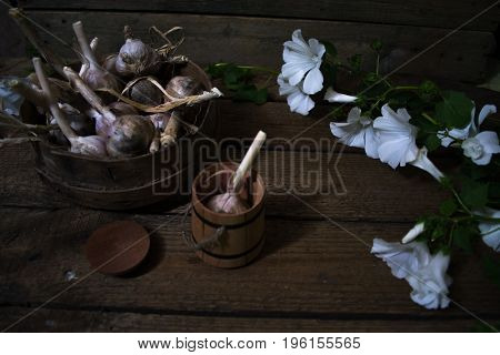 Harvest of garlic on a wooden old background
