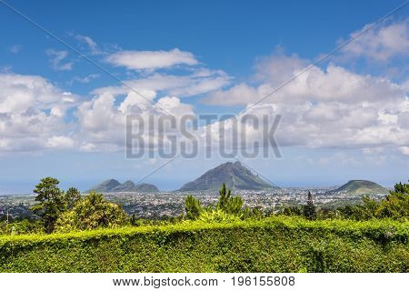 Landscape with mountain and town Gorges Viewpoint in Mauritius. Beautiful tropical paradise island.