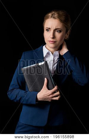 Tired Middle Aged Businesswoman Holding Digital Tablet And Looking Away Isolated On Black