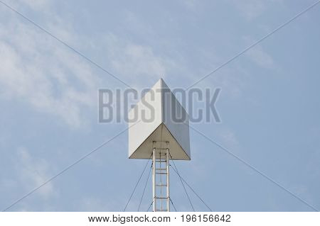 board with high iron structure on building rooftop in sunny day