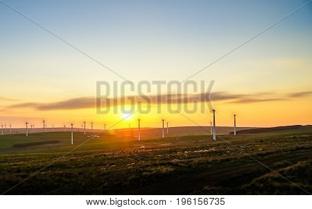 wind farm in a long exposure at sunset