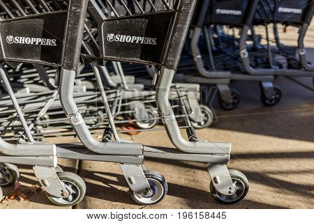 Fairfax, Usa - December 15, 2016: Black And Grey Shopping Carts With Shoppers Store Sign Word