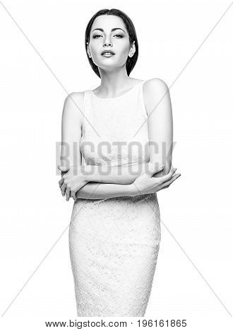 Portrait of business woman standing in white studio