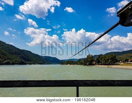A cable stretches across the Danube River to guid a ferry boat