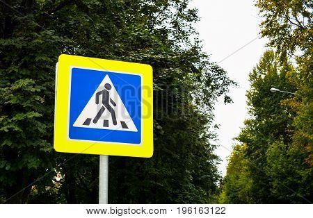 Road sign. Crosswalk on city street, pedestrian crossing