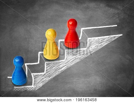 Game figures climbing stairs. Concept for motivation, power and competition.