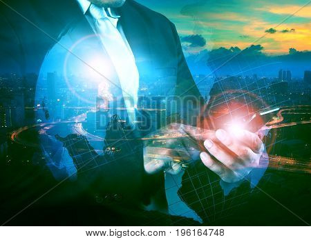 multi exposure business man touching on mobile phone screen with world map and modern city life background
