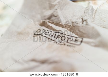 Fairfax, USA - January 2, 2017: Brown crinkled napkin with Chipotle sign word