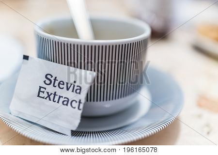Small Coffee Cup On Plate With Stevia Extract Packet