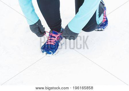 Tying Sport Shoes In Snow