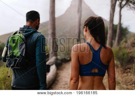 Healthy Young Couple Walk Through Mountain Trail