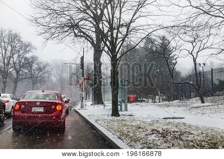 Washington Dc, Usa - January 7, 2017: Winter Snow Storm On Road With Stopped Cars And Us Naval Obser