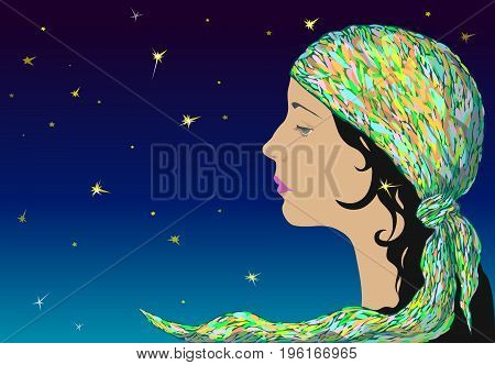 Profile of a young romantic girl in a motley kerchief against the starry sky