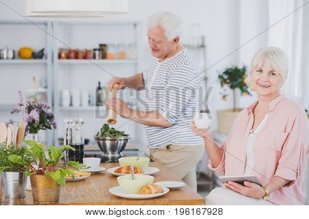 Senior Woman And Man In The Kitchen