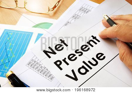 Net present value NPV documents on a table.