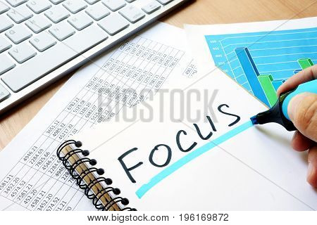Focus written in a note. Business concept.