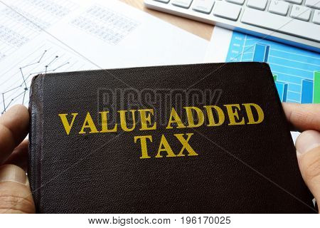Value added tax VAT written on a front of book.