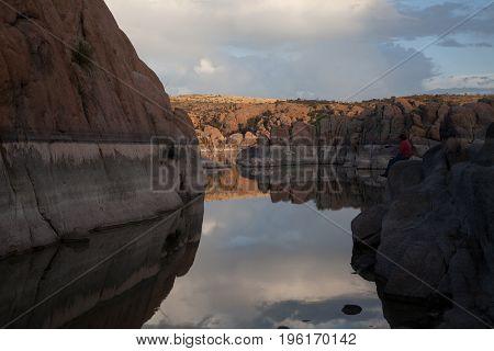 a storm forms at sunset at scenic Watson Lake Prescott Arizona