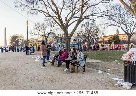 Washington Dc, Usa - January 28, 2017: Overflowing Trash Bins In National Mall With People Eating An