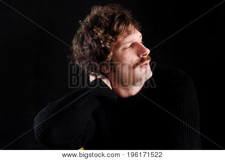 Portrait Of An Attractive Man On Black
