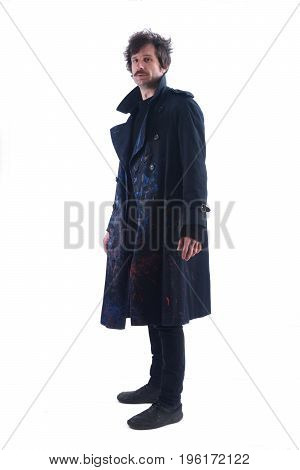 A man with a smeared coat on white
