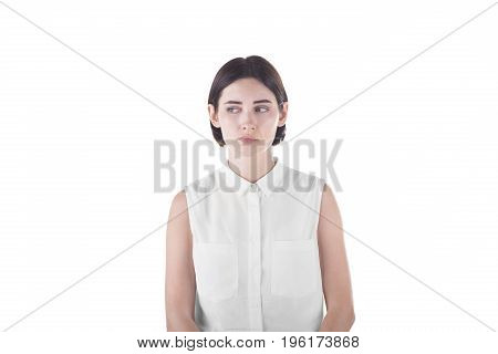 Close-up emotional portrait of a sad woman, isolated on a white background. A beautiful brunette woman tired, depressed and bewildered. Depression.