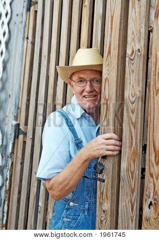 Farmer At The Barn