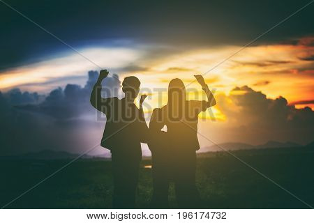 silhouette of Happy family having fun and enjoying journey in the park at the sunset time