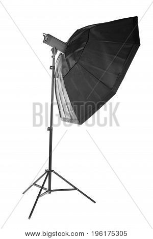Photostudio equipment: octobox, isolated on a white background. Professional photographic lighting on a tripot. Studio flash with soft-box on white background.
